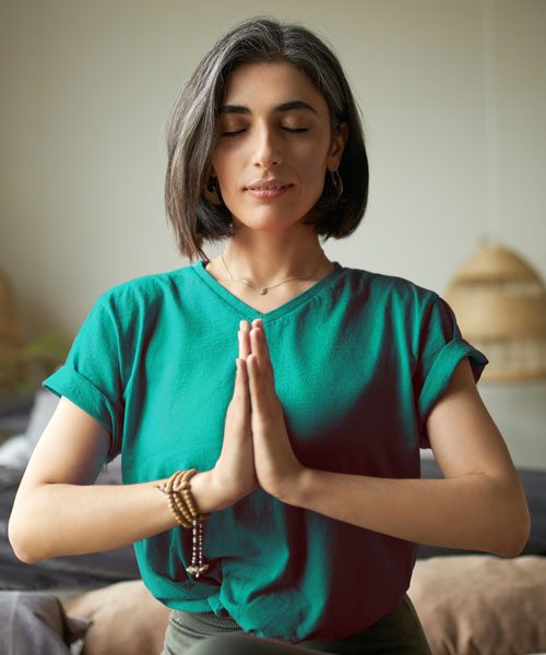 600_self-awareness-mindfulness-concept-young-woman-having-premature-graying-meditating-home-with-eyes-closed